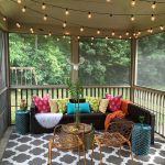 Gazebo, Wooden Floor, Patterned Grey Rug, Dark Brown Sofa, Colorful Pillows, Fairy Lamps, Golden Chair, Blue Rattan Side Table