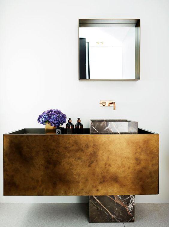 golden vanity, brown marble sink, golden faucet, mirror