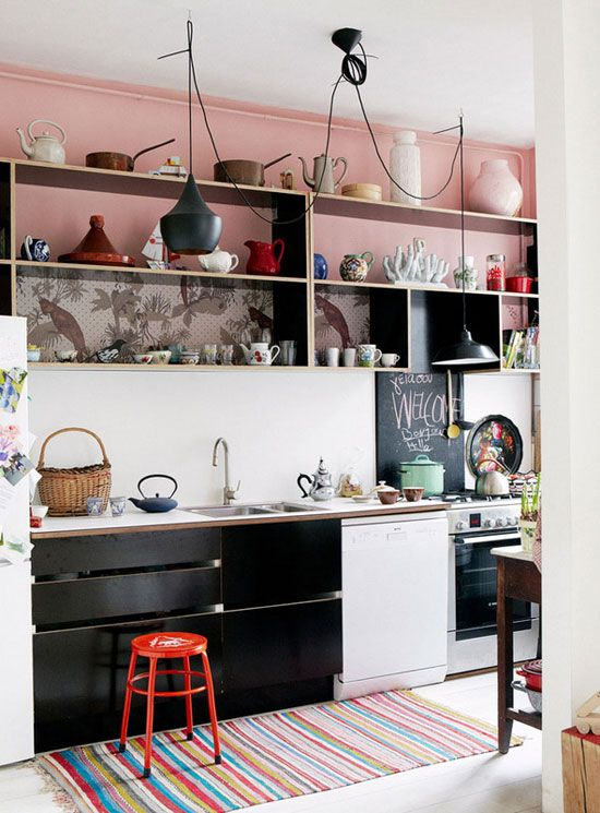 kitchen, white backsplash wall, black white kitchen bottom cabinet, white floor, pink upper wall, white fridge, black pendant, upper wooden shelves