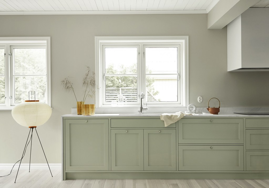 kitchen, white floor, white framed window, white wooden ceiling, pale green kitchen bottom cabinet