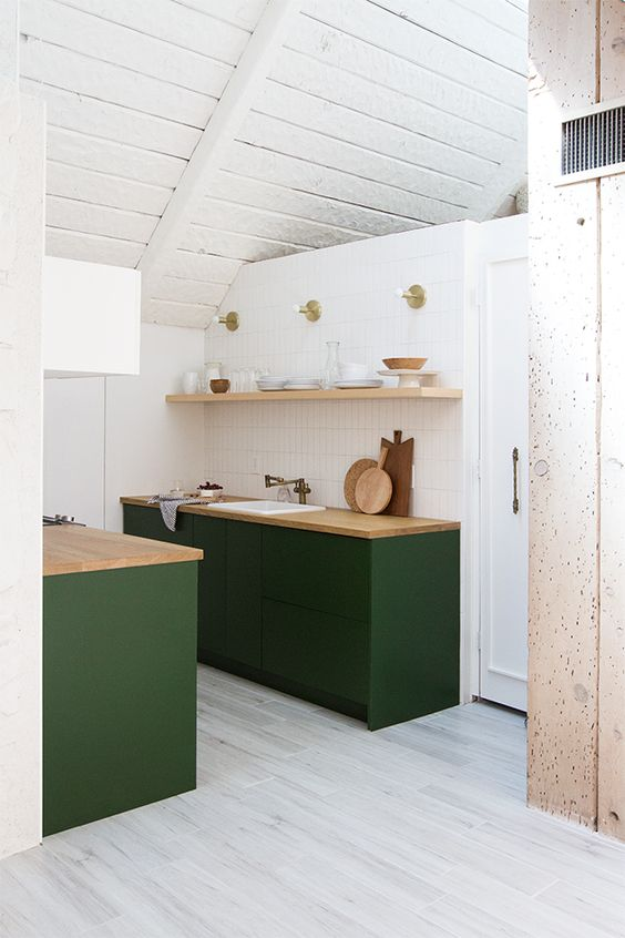 kitchen, white wall, white wooden sloping ceiling, grey floor, green bottom cabinet with wooden top, floating shelves