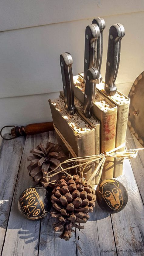 knives stand with books and filler, wooden table, wooden wall