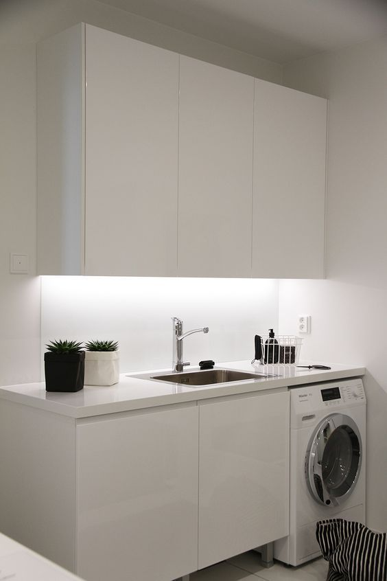 laundry machine under the kitchen top, white upper cabinet, white bottom cabinet