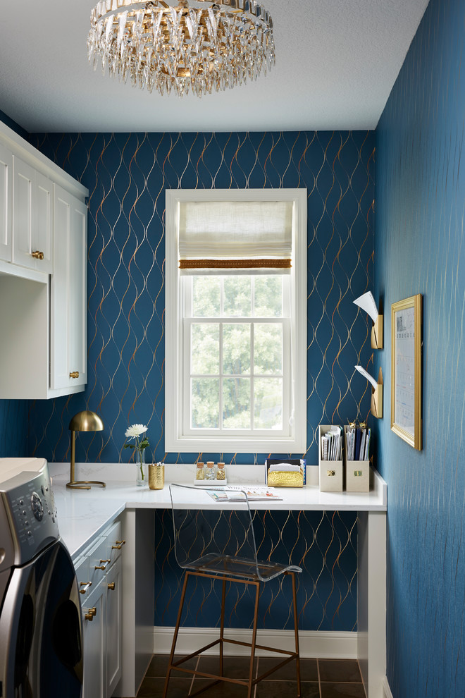 laundry room decorations blue walls gold pattern windows white cabinet white built in desk washing machine wall sconces frame ghost chair table lamp