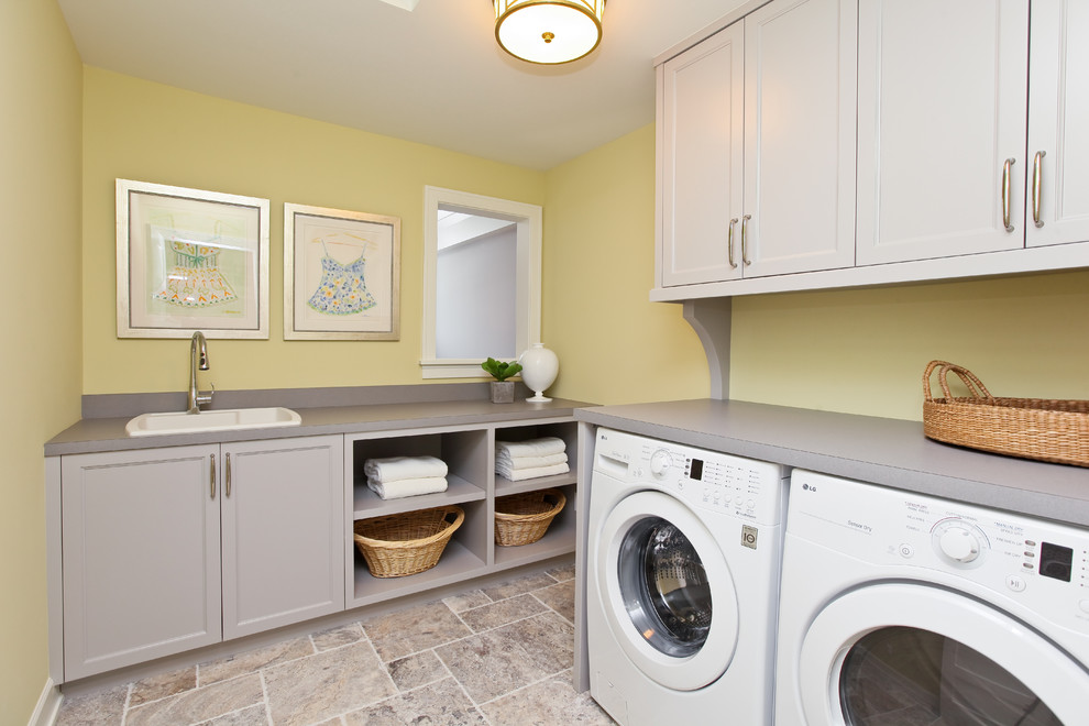 laundry room decorations silver frames yellow walls gray cabinets washing machine terra cotta tile shelves window pendant lamp