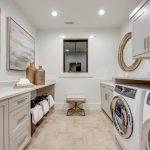 Laundry Room Decorations Wall Art Windows White Walls White Cabinets Round Wall Mirror Washing Machine Basket Bench Sink