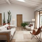 Living Room, Brown Floor, Rattan Rug, White Sofa, White Chair, Brown Leather. White Wall, Sliding Doors