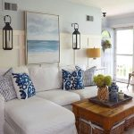 Living Room, Brown Floor, White Sofa, White Blue Wall, Sea Painting, Sconce, Wooden Table
