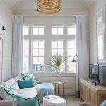 Living Room, Brown Floor, White Wooden Planks Wall, Rattan Chair, White Sofa, White Round Coffee Table, Golden Pendant, Wooden Cabinet, Floor Lamp, Tv