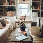 Living Room, Brown Rug, White Wall, White Ceiling, White Shelves, White Window Bench With Brown Cushion, Brown Sofa, Brown Chair, Coffee Table, Red Ottoman