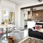 Living Room, Grey Seamless Floor, White Wall, Glass Door, Black Sofa, Refurbished Crate For Coffee Table, White Dining Table, Acrylic Chair, Open Kitchen