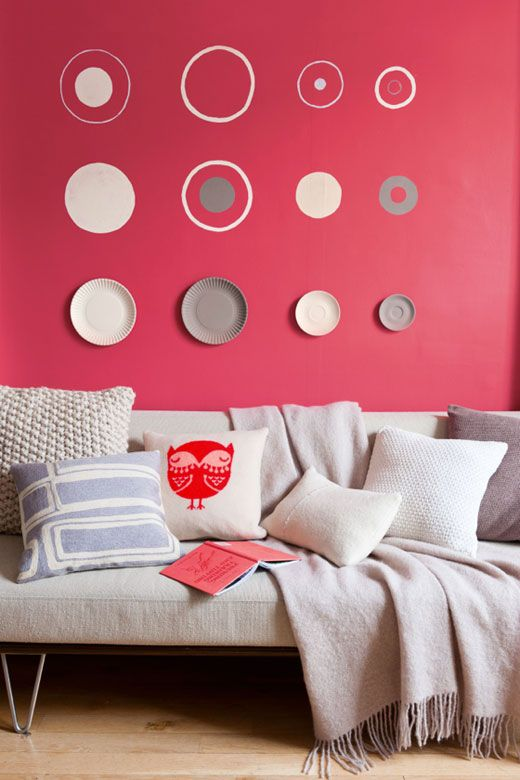 living room, pink wall, wooden floor, white sofa, white pillows
