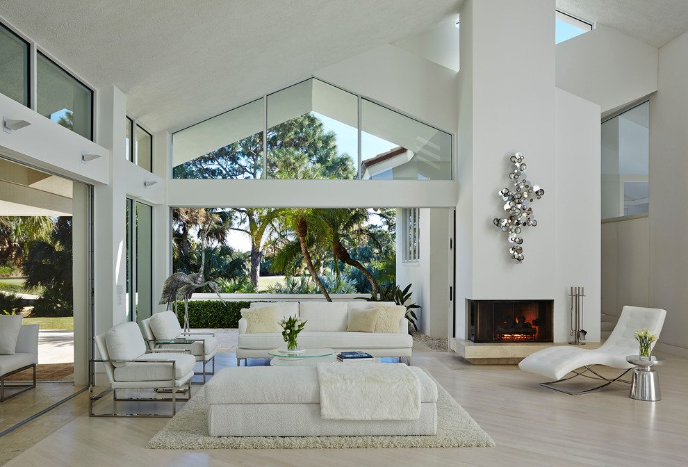 living room sets with chaise lounge wide glass windows white sofa white chairs white shag rug white bench fireplace silver wall decor floor tile chrome side table