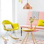 Living Room, White Floor, White Wall, Soft Pink Bench, Pink Coffee Table, Pink Rug, Copper Pendant, Yellow Rocking Chair