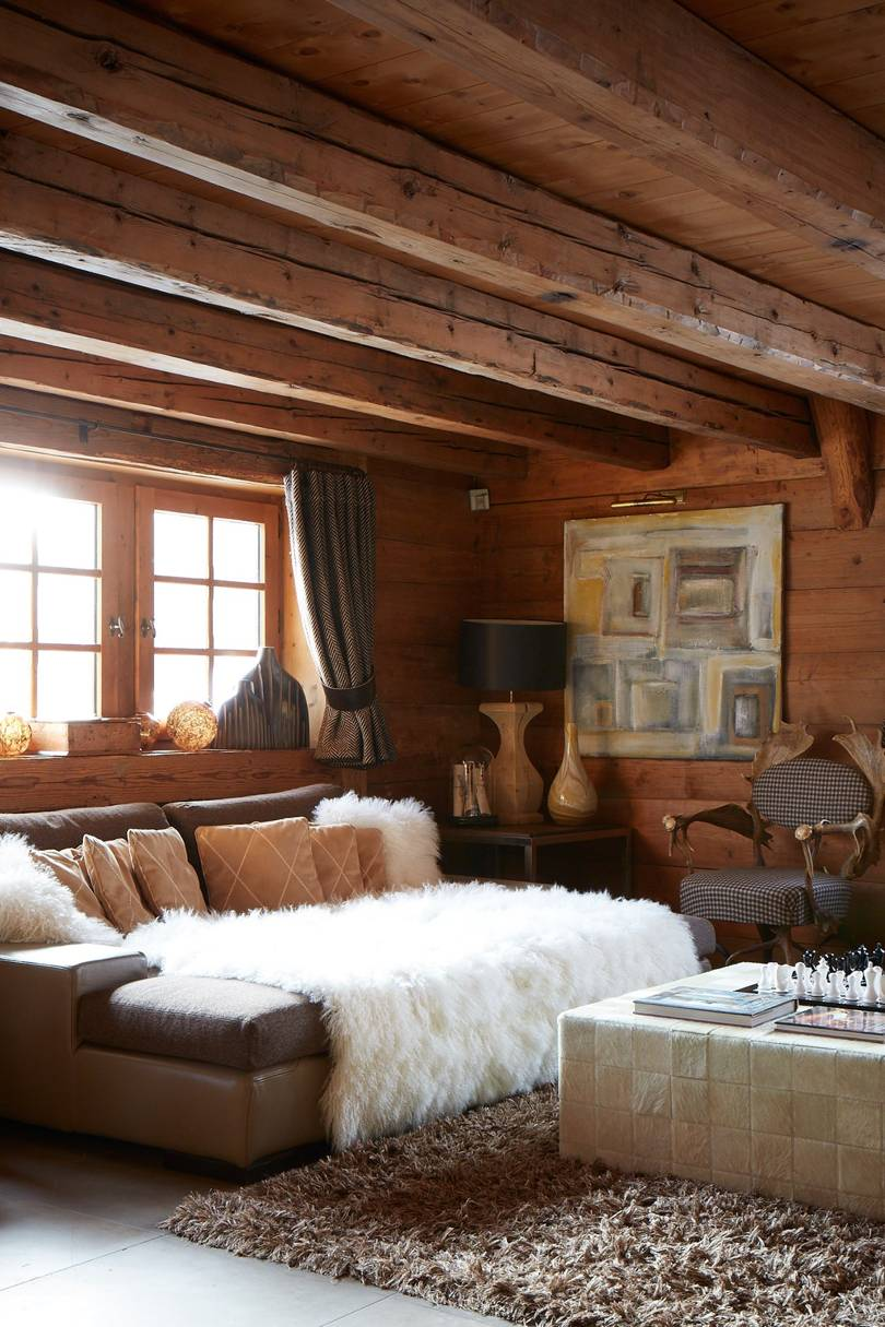 living room, white floor, wooden wall, wooden ceiling, wooden beams, window, lounge sofa, white coffee table, black table lamp