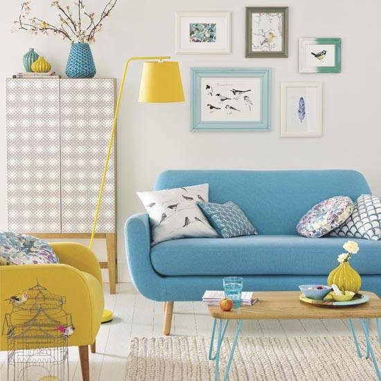 living room, white wooden floor, white wall, white patterned cabinet, blue sofa, yellow chair, yellow flor lamp, white rug, coffee table