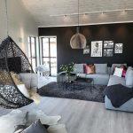 Living Room, Wooden Floor, Black Rug, Soft Blue Sofa, Black Tray Square Coffee Table, Black Rattan Swing, Pendant, Black Wall, White Wall
