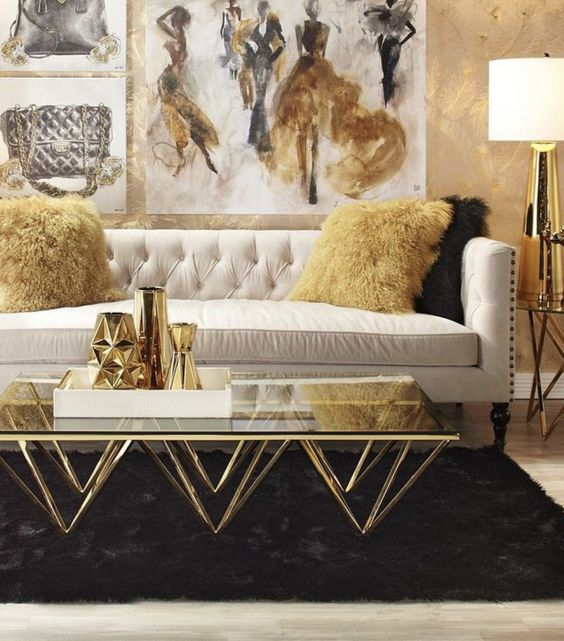 living room, wooden floor, black rug, white sofa, golden wall, golden coffee table with glass top, white covered table lamp with golden body