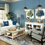 Living Room, Wooden Floor, Blue Patterned Rug, Blue Ainted Wall, White Sofa, White Coffee Table, White Cabinet, Floor Lamp, Pendants, White Patterned Curtain, Chair, Ottoman