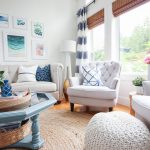 Living Room, Wooden Floor, Rattan Rug, White Wall, White Sofa, White Chair, White Woven Ottoman, Blue Glass Coffee Table