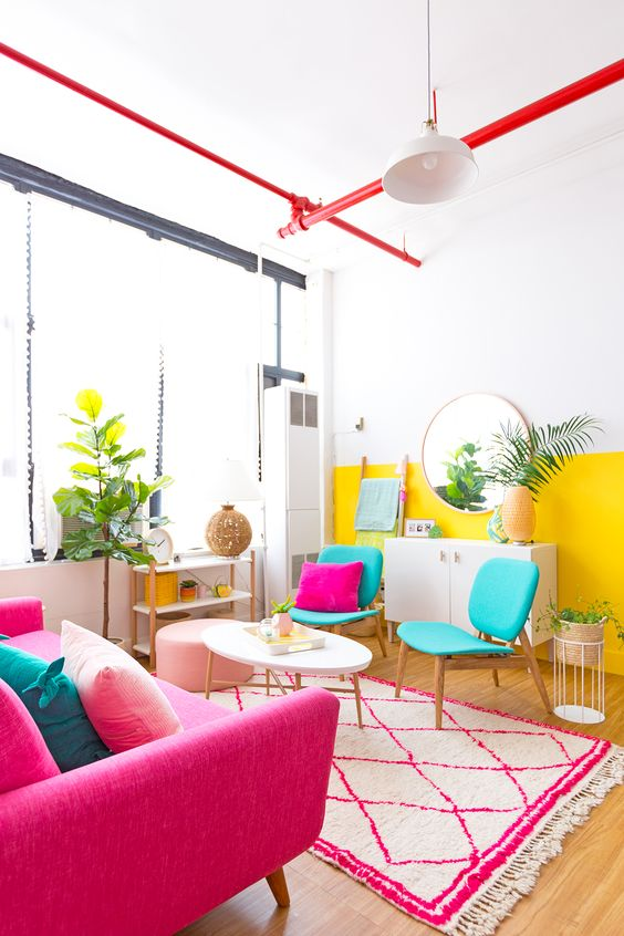 living room, wooden floor, white pink patterned, white wall, red pipe, yellow white wall, turquoise chair, white coffee table, shocking pink sofa