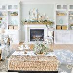 Living Room, Wooden Floor, White Shelves, White Fireplace, Beige Sofa, Rattan Coffee Table