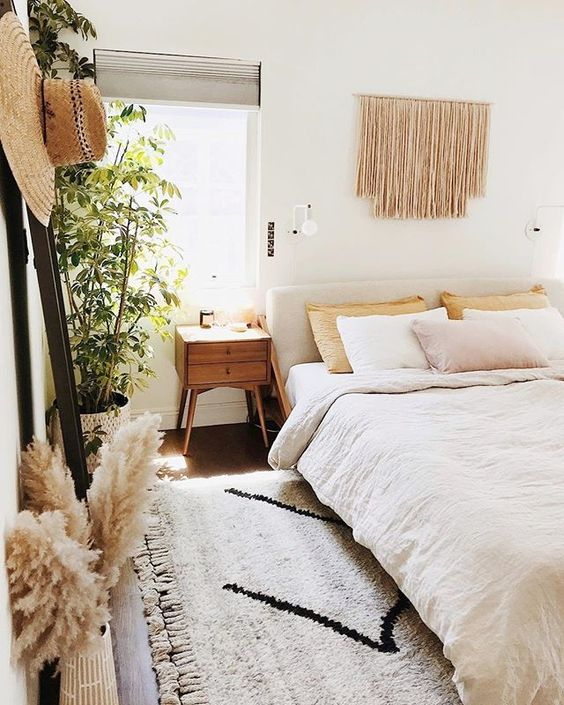 master bedroom, wooden floor, white rug, white wall, bohemian wall decoration, wooden side table, white bedding, wooden rack