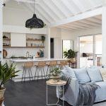 Open Kitchen, Black Floor, White Wall, White Vaulted Ceiling, White Kitchen, Rattan Stools, Blue Sofa, Rug