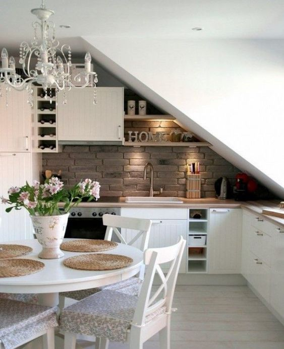 open room, wooden floor, white wall, open brick backsplash, whtie cabinet, wooden top, white dining set, shelves