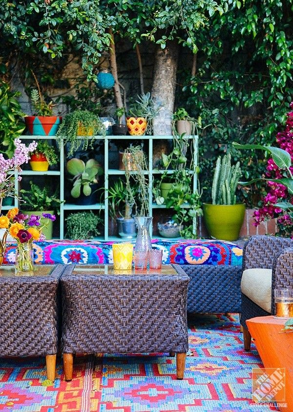 patio, colorful patterned rug, purple rattan bench with colorful pattern, purple rattan chair, purple rattan tables with glass top, orange wooden slab