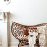 Rattan Baby Crib, White Cushion, Wooden Floor, White Wall