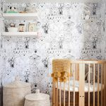 Round Wooden Baby Crib With White Cushion, Wooden Floor, White Animal Pattern Wallpaper, Rattan Baskets, White Floating Shelves
