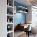 Study Nook By The Window, Blue Wall, White Box, White Floating Shelves, Wooden Table, Wooden Built In Bench, Grey Cushion