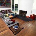 Sunken Living Room, Wooden Floor, White Wall, Fireplace, Grey Sofa, Wooden Side Table, Wooden Bookshelves