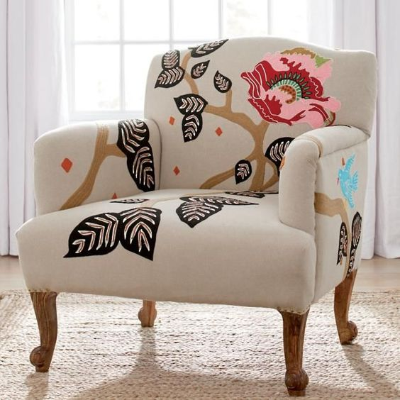 white chair with flower and leaves pattern, soft brown rug