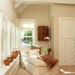 White Lounge Chair, Beige Floor, Beige Wall, White Built0in Cabinet, White Window Bay, Large Window