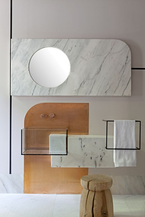 white marble floating vanity, clear glass sink with black frame, black metal frame for towel rack, round mirror, marble background, off white wall
