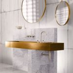White Marble Floor, White Marble Vanity With Large Rectangular Golden Sink, Golden Framed Round Mirror, White Wall