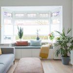 White Window Seat, Wide Round Table, Blue Cushion, Pillows, Wooden Floor, White Storage, Grey Sofa, Grey Bench