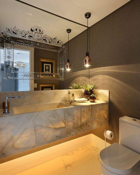white yellow floating marble vanity, brown wall, mirror, white marble, pendants, white toilet