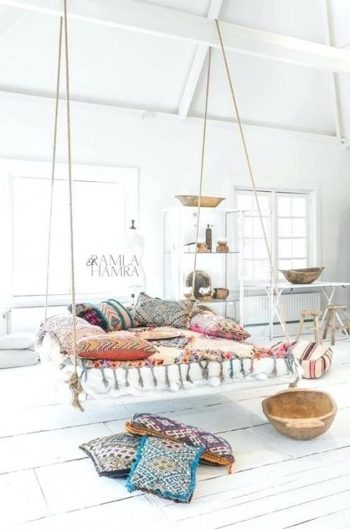 wide square swing with rope, colorful pillow, white wooden floor, white table and rack