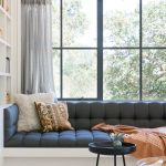 Window Bay, White Built In Bench, White Built In Shelves, Black Tufted Cushion, Black Trimmed Window, Grey Cushion