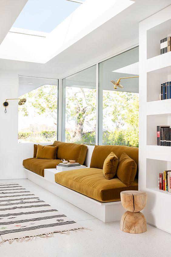 window seat in the corner, white bench, white wall, white ceiling, large window, ceiling window, white shelves