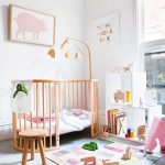 Wooden Baby Crib, Wooden Stool, Colorful Rug, White Sheles, Grey Floor, White Wall