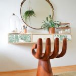 Wooden Hands Chair, White Wall, Floating Cabinet, Round Mirror, Wooden Floor, Rug