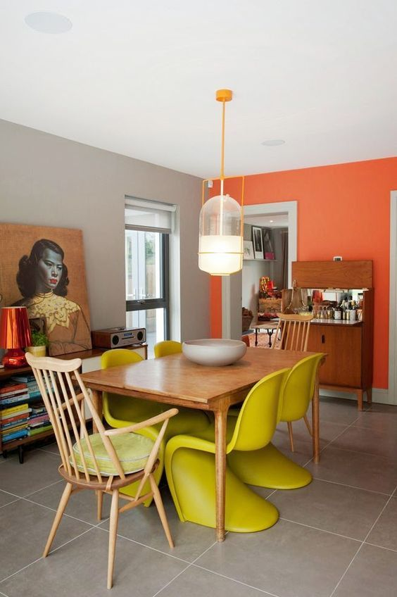 yellow chairs on dining set, wooden chair, beige floor tiles, white ceiling, grey wall, orange wall, wooden table, pendant, woden shelves