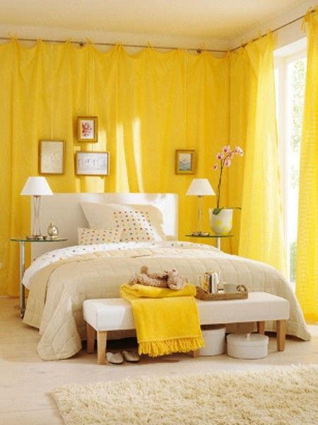 yellow curtain on the bedroom, white floor, white rug, white bedding, white bench, side tables, white table lamp