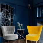Yellow Grey Velvety Chairs, Wooden Floor, Dark Blue Wall, Round Wide Table