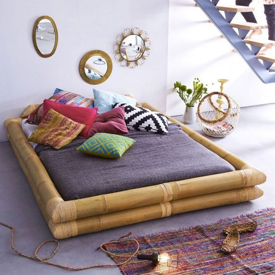 bamboo frame, purple bed, grey floor, colorful pillows, purple rug