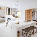 Bedroom, White Floor, White Study Table, White Wall, White Linen, Wooden Stools, White Ceiling Fan, Built In Shelves, Rattan Door Built In Cabinet
